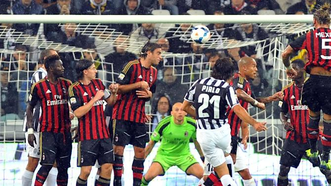 Juventus midfielder Andrea Pirlo, back to camera center, scores during a Serie A soccer match between Juventus and AC Milan at the Juventus stadium, in Turin, Italy, Sunday, Oct. 6, 2013