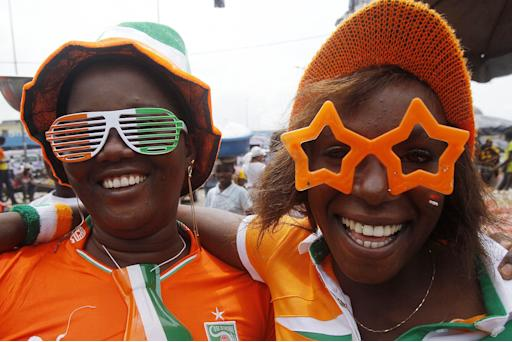 Ivory Coast fans prepare for their team's African Nations Cup final against Ghana, in Abidjan