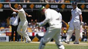 Australia's Johnson celebrates after taking the wicket of England's Trott during the second day's play of the first Ashes cricket test match in Brisbane