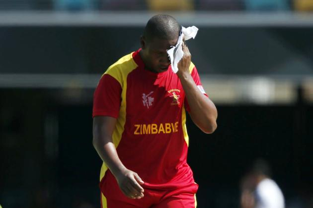 Zimbabwe's bowler Tinashe Panyangara wipes the sweat from his forehead during the Cricket World Cup match against Pakistan in Brisbane