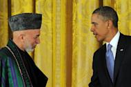"""US President Barack Obama and his Afghan counterpart Hamid Karzai leave after a joint press conference at the White House on January 11, 2013. Obama has said the US goal in Afghanistan was """"within reach"""" as he vowed to move ahead with a timetable to end the 11-year-old military campaign and focus on a broad domestic agenda"""