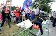 Anti-government protesters clash with police during a demonstration in Manila. Philippine President Benigno Aquino has urged all Filipinos to unite in sending a message to China over a territorial row, insisting his country would not give in to its more powerful neighbour