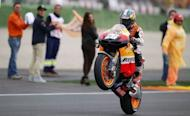Honda's Spanish rider Dani Pedrosa celebrates after winning the MotoGP race at Ricardo Tormo racetrack in Cheste near Valencia on November 11, 2012 Pedrosa won an incident-packed Valencia MotoGP on Sunday, the final race of the season