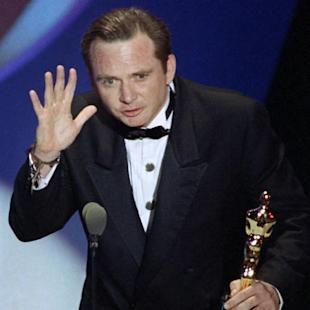 "FILE - This March 26, 1991 file photo shows Michael Blake accepting the Oscar for best adapted screenplay for ""Dances with Wolves"" at the 63rd Annual Academy Awards in Los Angeles. Blake's business partner, Daniel Ostroff, says the 69-year-old died Saturday in Tucson, Ariz., after a long battle with cancer.  (AP Photo/Reed Saxon, File)"