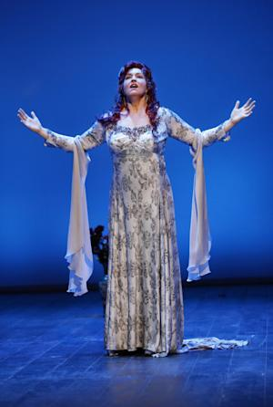 """In this Feb. 17, 2012 photo provided by the City Opera, Melody Moore performs as Regine Saint-Laurent during a dress rehearsal of Rufus Wainwright's """"Prima Donna"""" at the Brooklyn Academy of Music, in Brooklyn, New York. (AP Photo/City Opera, Carol Rosegg)"""