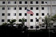 The US flag flutters in front of the US consulate in Hong Kong on June 10, 2013. Up to a thousand supporters of US intelligence leaker Edward Snowden are expected to stage a protest in Hong Kong on Saturday to call on the government to protect him, organisers told AFP