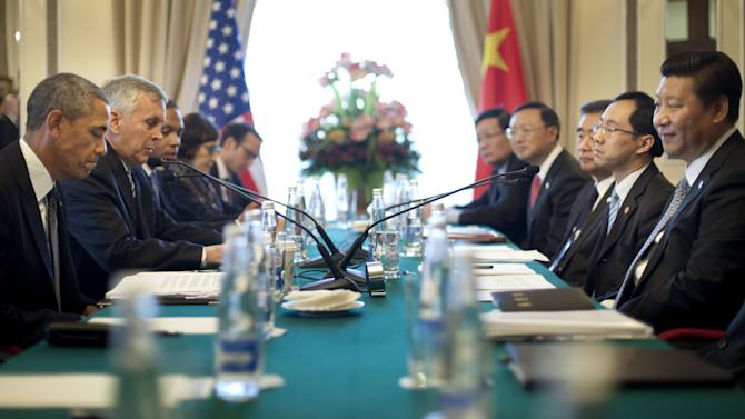U.S. President Barack Obama, left, China's President Xi Jinping, right, and members of their delegations, attend their bilateral meeting at the G20 Summit, Friday, Sept. 6, 2013 in St. Petersburg, Russia. (AP Photo/Pablo Martinez Monsivais)