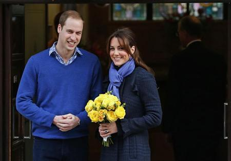 Britain's Prince William leaves the King Edward VII hospital with his wife Catherine, Duchess of Cambridge