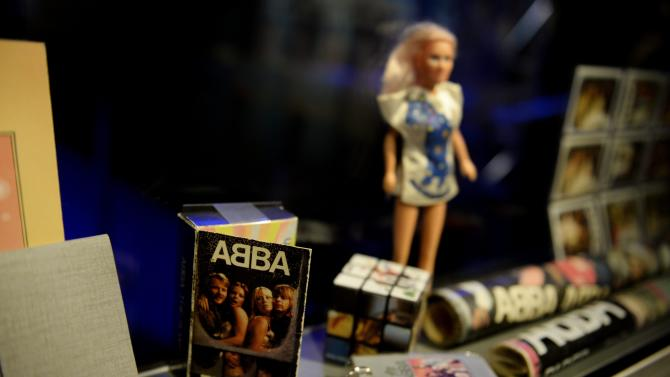 "Swedish music group ABBA memorabilia seen during a press preview of 'ABBA The Museum' at the Swedish Music Hall of Fame in Stockholm, Sweden, Monday May 6, 2013. A museum opens in Stockholm on Tuesday to show off band paraphernalia, including the helicopter featured on the cover of their ""Arrival"" album, a star-shaped guitar and dozens of glitzy costumes the Swedish band wore at the height of its 1970s fame. (AP Photo/Scanpix Sweden/Jessica Gow) SWEDEN OUT"