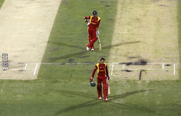 Zimbabwe's Craig Ervine watches as team mate Sean Williams walks off the field after being dismissed for 33 runs during their Cricket World Cup match against Pakistan at the Gabba in Brisbane