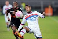 Lyon's French forward Alexandre Lacazette runs with the ball during the French L1 football match Lyon vs Lorient at the Gerland stadium in the eastern-central French city of Lyon. Lyon sustained their faint hopes of playing in next season's Champions League by fighting back from two goals down to beat Lorient 3-2