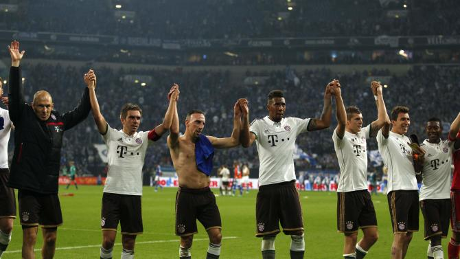 Bayern Munich's players celebrate victory against Schalke 04 after the German first division Bundesliga soccer match in Gelsenkirchen