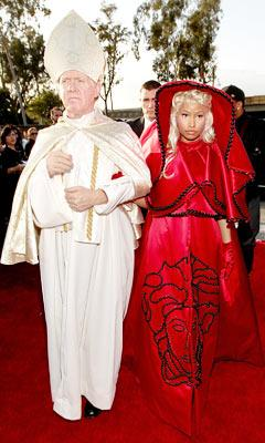 Nicki Minaj Walks Grammy's Red Carpet with Pope Imposter