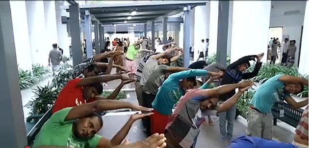 Free yoga lessons being taught in foreign worker dorm centres. (YouTube screengrab)