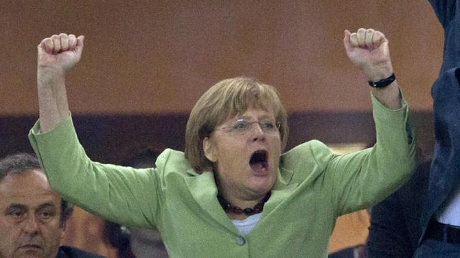 The June 22, 2012 file photo shows German Chancellor Angela Merkel celebrating during the  Euro 2012  quarterfinal soccer match between Germany and Greece in Gdansk, Poland, Friday, June 22, 2012. Germany won 4-2. Merkel runs for a third term in Germany's general election on Sunday, Sept. 22, 2013