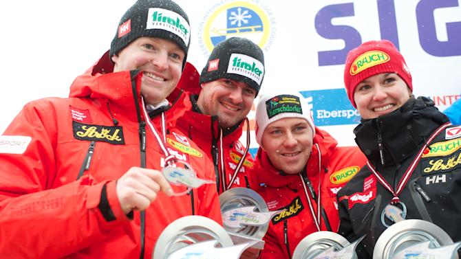 (L TO R) Austria's Andreas Linger, Wolfgang Linger, Manuel Pfister and Nina Reithmayer celebrate after placing second in the Luge Team Relay event of the Luge World Cup in Sigulda on February 19, 2012. Italy won the race ahead of second-placed Austria and third-placed Germany. AFP PHOTO / ILMARS ZNOTINS (Photo credit should read ILMARS ZNOTINS/AFP/Getty Images)
