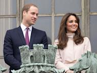 Prince William, Duke of Cambridge and Catherine, Duchess of Cambridge stand on the balcony of The Guildhall during their first official visit to Cambridge on November 28, 2012 in Cambridge, England -- Getty Images