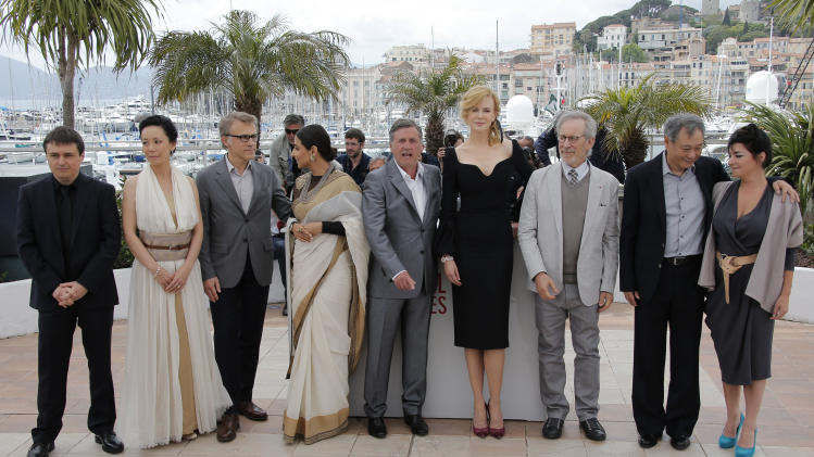 Members of the jury from left, Cristian Mungiu, Naomi Kawase, Christoph Waltz, Vidya Balan, Daniel Auteuil, Nicole Kidman, jury president Steven Spielberg, Ang Lee and Lynne Ramsay pose during a photo call for the jury at the 66th international film festival, in Cannes, southern France, Wednesday, May 15, 2013. (AP Photo/Lionel Cironneau)