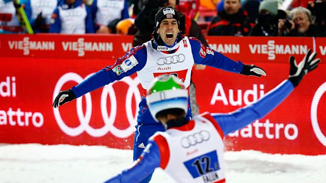Team Norway celebrates winning the men's large hill team ski jumping final at the Nordic World Ski Championships in Falun