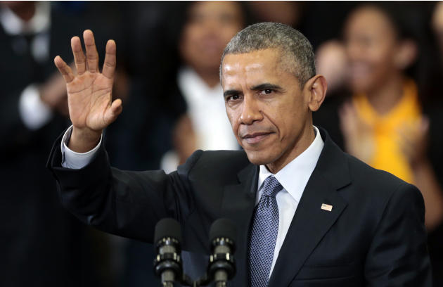 President Barack Obama waves to a group of people before he speaks at Lawson State Community College, Thursday, March 26, 2015, in Birmingham, Ala. The president talked about the progress to financial