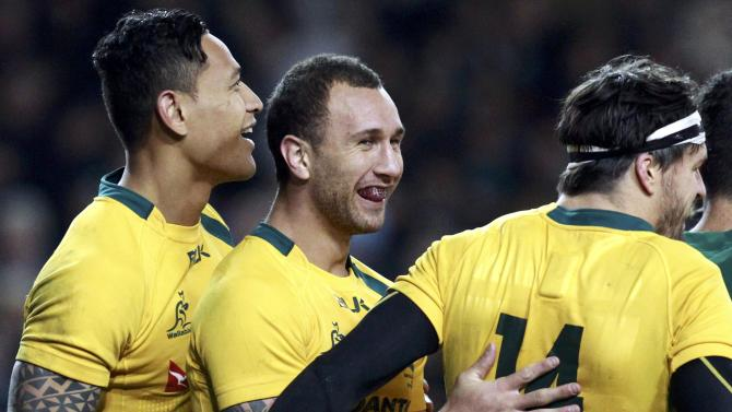 Australia's Cooper is congratulated by his team mates after scoring against Ireland in their International rugby union match in Dublin