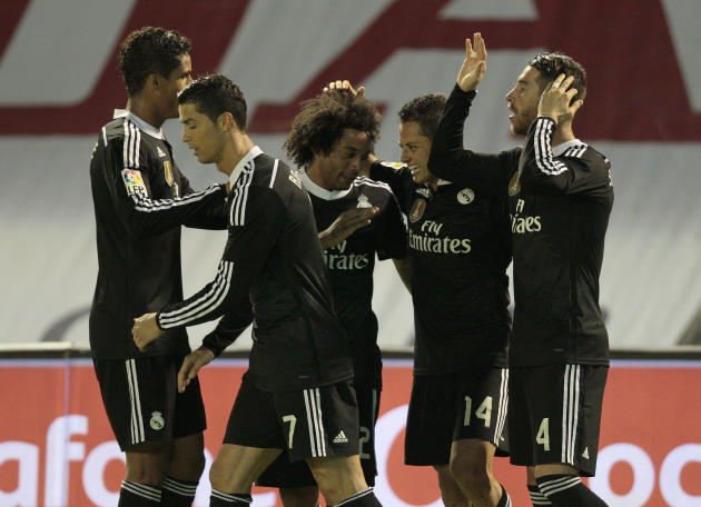Real Madrid's Chicharito from Mexicois congratulated by his teammates after he scored their fourth goal during a Spanish La Liga soccer match between RC Celta and Real Madrid, at the Balaídos stad