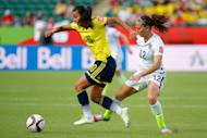 Yoreli Rincon of Colombia controls the ball against Lauren Holiday of the United States in the first half in the FIFA Women's World Cup 2015 Round of 16 match June 22, 2015 in Edmonton, Canada