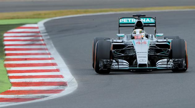 Hamilton on pole at British GP, Rosberg pleased to miss out