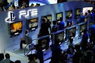 Gamers play video games at the Sony Playstation booth during the Electronic Entertainment Expo in Los Angelese, on June 7, 2011. Sony has been fined by Britain's data watchdog for a breach that compromised the personal information of millions of customers using PlayStation videogames consoles