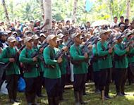 Communist rebels stand in formation on the southern Philippine island of Mindanao on December 26, 2010. The Philippines says that peace talks with communist rebels have collapsed and a target of ending the decades-long insurgency by 2016 is impossible to achieve