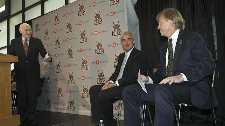 CORRECTS TO LASRY AT CENTER, INSTEAD OF AT RIGHT - Milwaukee Bucks owner Herb Kohl introduces investment firm executives Marc Lasry, center, and Wesley Edens right, at a news conference after reaching a deal to sell the franchise Wednesday, April 16, 2014, in Milwaukee. The deal is subject to approval by the NBA and its Board of Governors