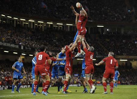 Wales' captain Alun Wyn Jones receives the ball in the line out against Italy, during the Six Nations Championship rugby union match at the Millennium Stadium, Cardiff, Wales