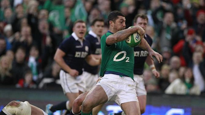 Ireland's Rob Kearney, right, breaks throuh to score a try despite being tackled by Scotland's Ryan Wilson during their Six Nations Rugby Union international match at the Aviva Stadium, Dublin, Ireland, Sunday, Feb. 2, 2014. (AP Photo/Peter Morrison)