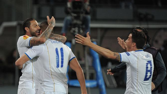Porto's Nabil Ghilas, center, is cheered by teammates after scoring during an Europa League, round of 16 return-leg soccer match against Napoli at the Naples San Paolo stadium, Italy, Thursday, March 20, 2014