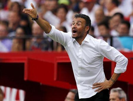 Barcelona's coach Enrique reacts during their soccer match against Sevilla in Seville