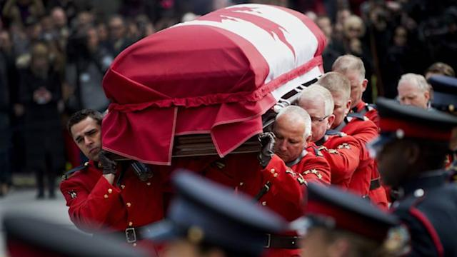 Mourners gather to pay respects to Jim Flaherty