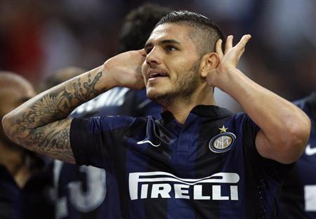 Inter Milan's Mauro Icardi celebrates after scoring against Juventus during their Italian Serie A soccer match at the San Siro stadium in Milan September 14, 2013. REUTERS/Alessandro Garofalo