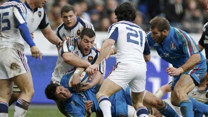 Italy's Alessandro Zanni fights for the ball with France's Rabah Slimani during their Six Nations rugby union match at the Stade de France in Saint-Denis