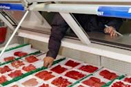 "File photo shows an employee arranging imported beef at a supermarket in Jakarta. The US trade representative has called for Indonesia to lift its import ban on some US beef products, saying there was ""no evidence"" that a Californian mad cow case had tainted food markets"