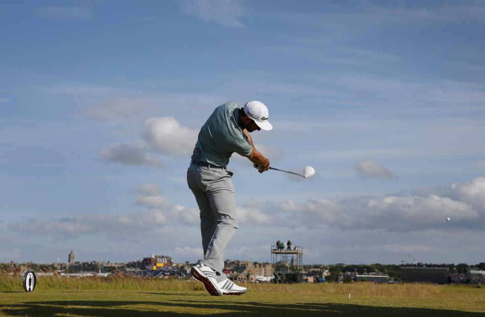 Johnson of the U.S. hits his tee shot on the 16th hole during the second round of the British Open golf championship on the Old Course in St. Andrews, Scotland