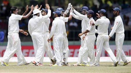India's Ashwin celebrates with his teammates after taking the catch to dismiss Sri Lanka's Thirimanne during the final day of their third and final test cricket match  in Colombo