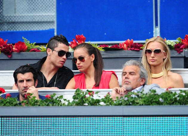 Real Madrid Player Cristiano Ronaldo (2nd L) Chats With His Girlfriend Irina Shayk While Seated With Portuguese Getty Images