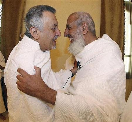 Saudi Grand Mufti Sheikh Abdul-Aziz Al al-Sheikh (R) embraces Saudi Prince Khaled Al Faisal, Emir of Mecca, at Namira Mosque on the plains of Arafat, outside Mecca, December 7, 2008. REUTERS/Saudi Press Agency/Handout