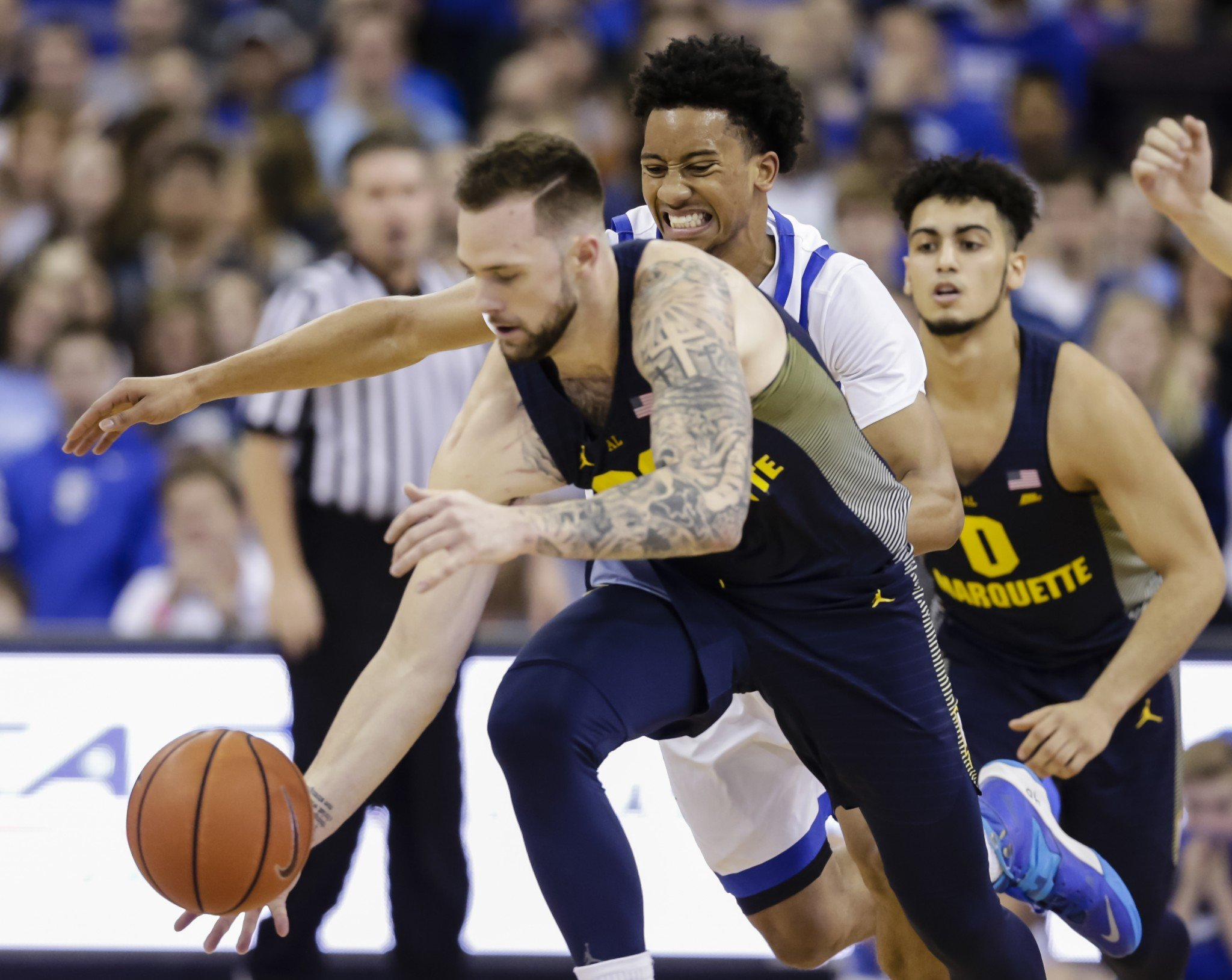 Katin Reinhardt led Marquette with 21 points in an upset over No. 7 Creighton. (AP Photo/Nati Harnik)