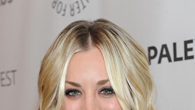 Kaley Cuoco  poses on arrival at the Paley Center for Media's PaleyFest, honoring The Big Bang Theory at the Saban Theatre, Wednesday March 13, 2013 in Los Angeles, California. (Photo by Kevin Parry/Invision/AP)