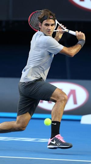 Roger Federer of Switzerland plays a backhand in his second round match against Nikolay Davydenko of Russia during day four of the 2013 Australian Open at Melbourne Park on January 17, 2013 in Melbourne  -- Getty Images
