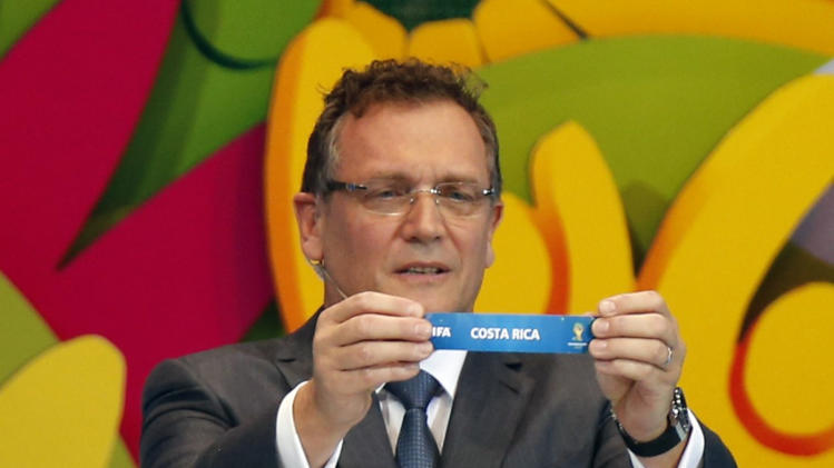 "FIFA Secretary General Jerome Valcke holds the slip showing ""Costa Rica"" during the draw for the 2014 World Cup at the Costa do Sauipe resort in Sao Joao da Mata"