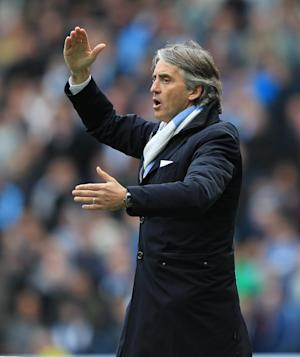 Roberto Mancini has revealed his frustration at the lack of new signings