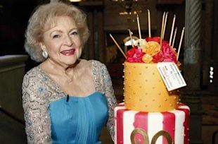 Betty White celebrates her 90th birthday with a custom Betty Crocker cake.