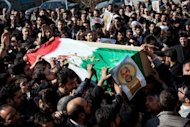Iranians carry the coffin of a commander shot dead in Syria, during his funeral procession in Tehran on February 14, 2013. Syria's army and rebels were preparing for a major battle for control of strategic airports in Aleppo, a watchdog said, four days after insurgents launched assaults on airbases in the northern province.